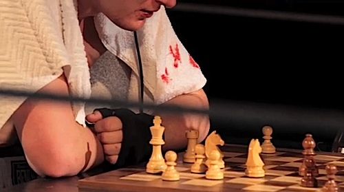 Round 3 of the Chessboxing match, sweating, bloody and heart pumping, try to think of your next move in chess against an equally challenged opponent.